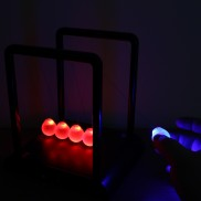 Illuminated Newtons Cradle