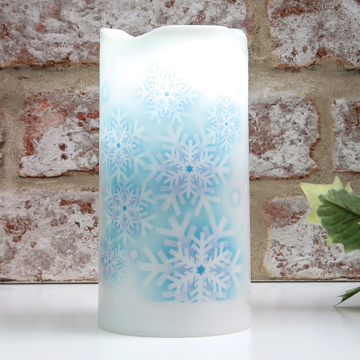 Click to view product details and reviews for Snowflake Projector Candle.