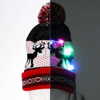 cc3ed528a83 Keep cosy and spread a touch of Christmas cheer with this stylish knitted reindeer  beanie hat with colourful LEDs! Read more.