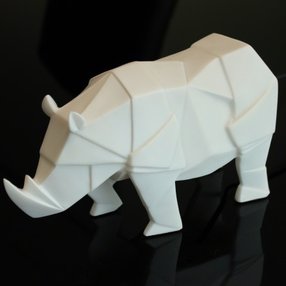 A Sturdy Rhino In An Angular Origami Styled Design Softened By A Warm White  LED. Read More.