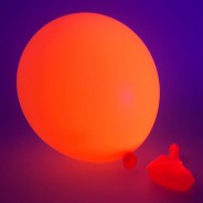UV Neon Balloons 6 Orange under UV light