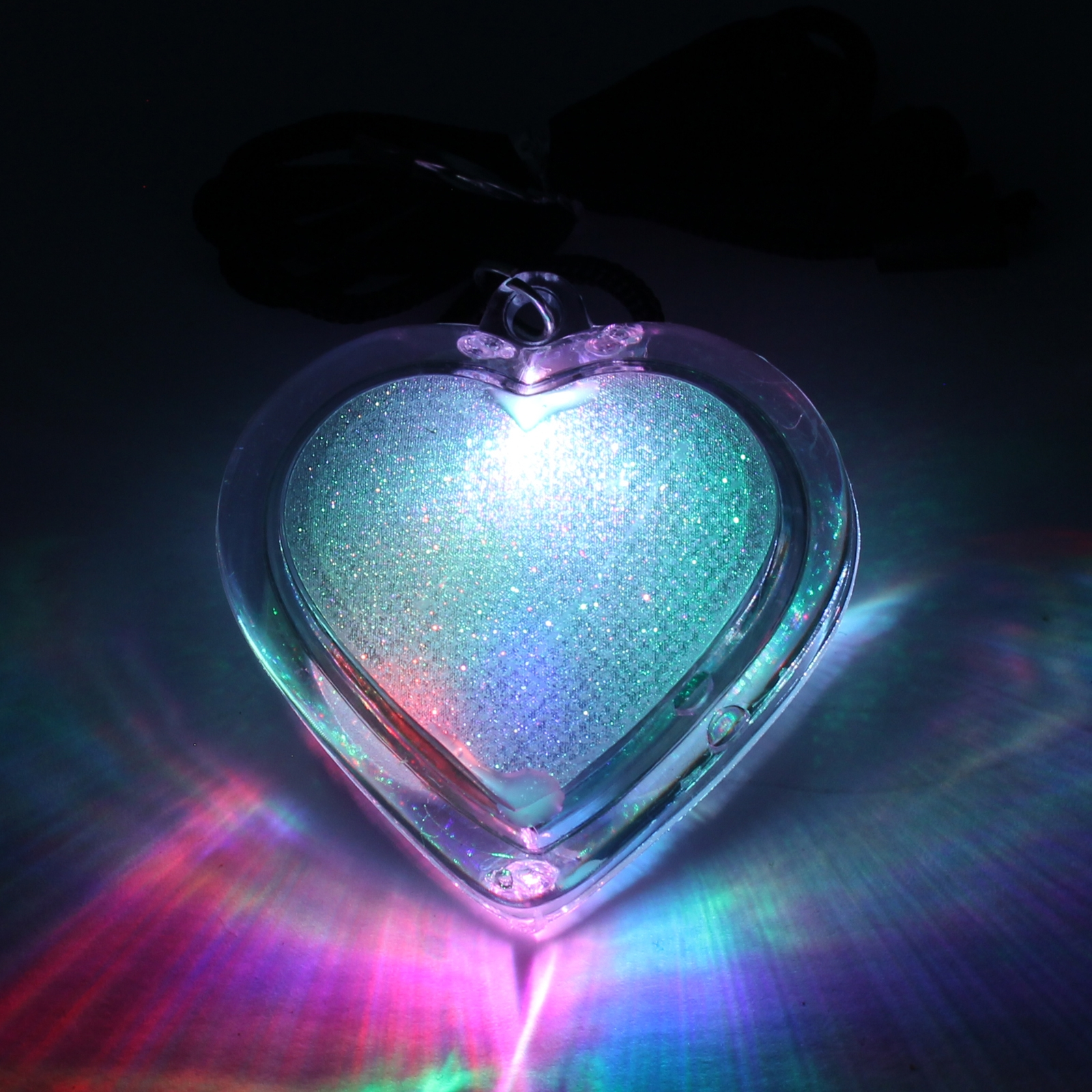 Click to view product details and reviews for Flashing Glitter Heart Necklaces Wholesale.