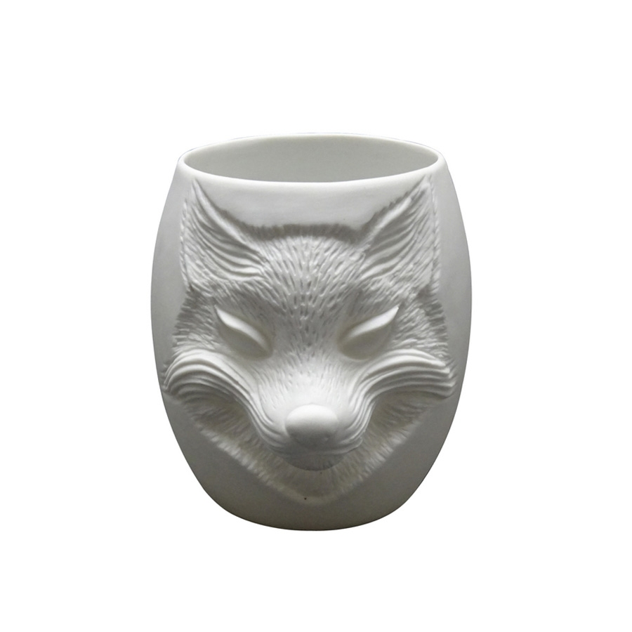 Click to view product details and reviews for Fox Face Porcelain Tealight Holder.