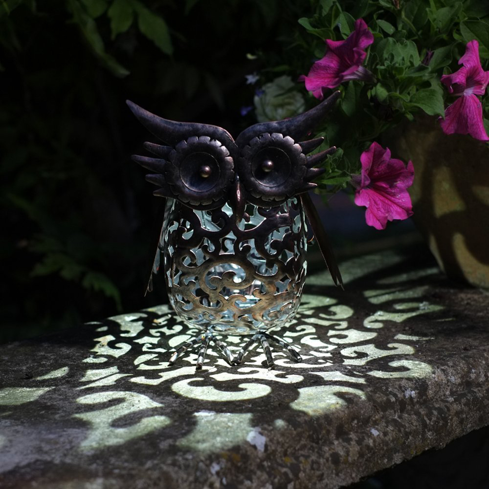 Click to view product details and reviews for Solar Scroll Owl.